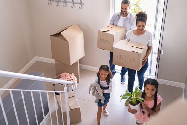 multiethnic-family-moving-in-new-home-NH