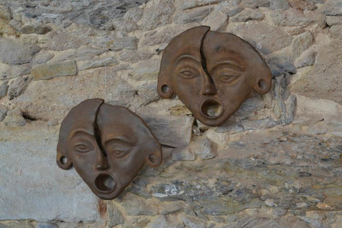 _Máscara__Esculturas em argila fundida em pó de ferro.jpg