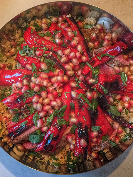 Gegrilde biefstuk en paprika & granaatappel, citroen couscous salade