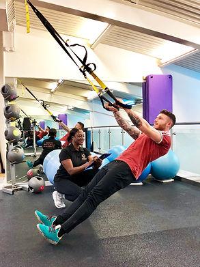 Lifelines gym instructor with member.jpg