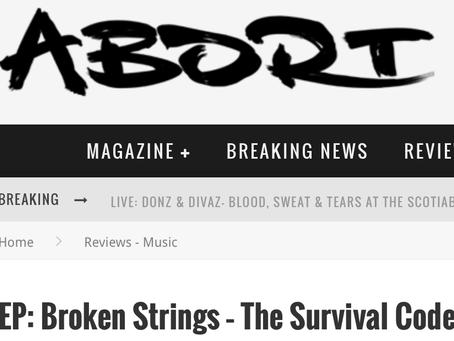 REVIEW BROKEN STRINGS -ABORT MAG