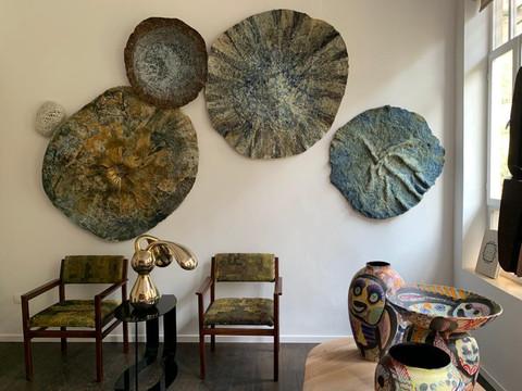 Moon Installation by Ohad Tsfati Golden Dorris by Do Carmon Anthropoid Vases by Gur Inbar Klint Armchairs by Adva Kramer