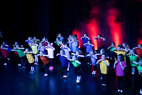 Infant cast performing a musical theatre number
