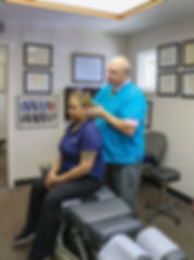 Toledo chiropractor adjusts patient