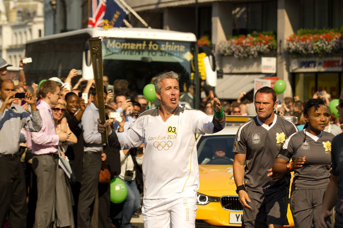 Kevin Craig carrying the Olympic Torch