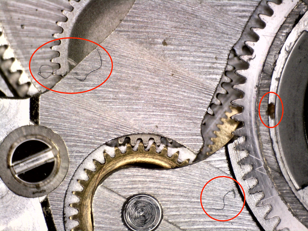 Watchmakers leave no trace. Unlike this example of dirt, hair and scratches on this swiss watch.