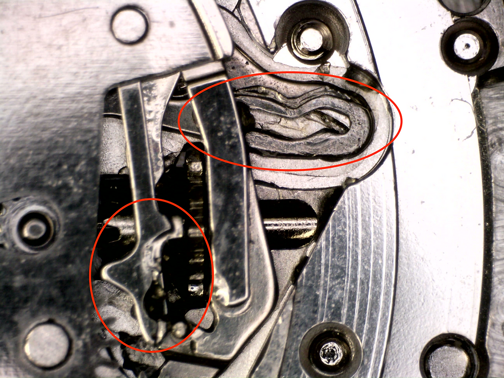 This is an example of over-lubrication. Watchmakers should leave no trace they were working inside a watch. This is a poor example of watchmaking.