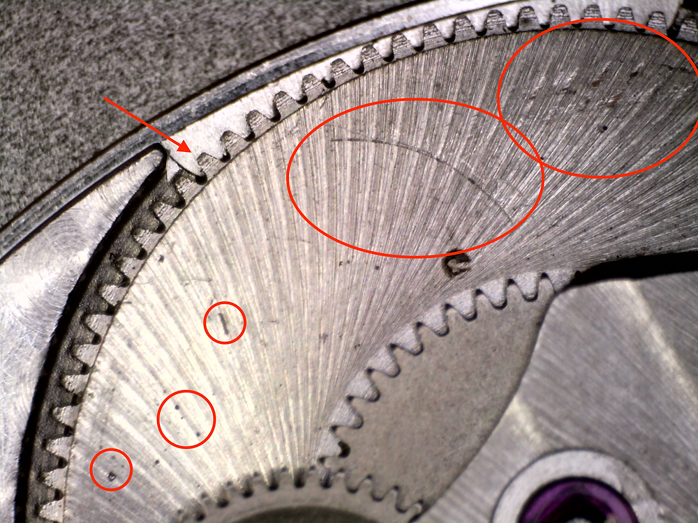 Watchmakers never leave Dirt, hair and scratches on the mainspring barrel of swiss watch