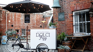The Dolci Fizz Tricycle at Southsea Castle serving Prosecco Cocktails as welcome drinks for The Strong Island 10 year Anniversary Social! Loved this setup!