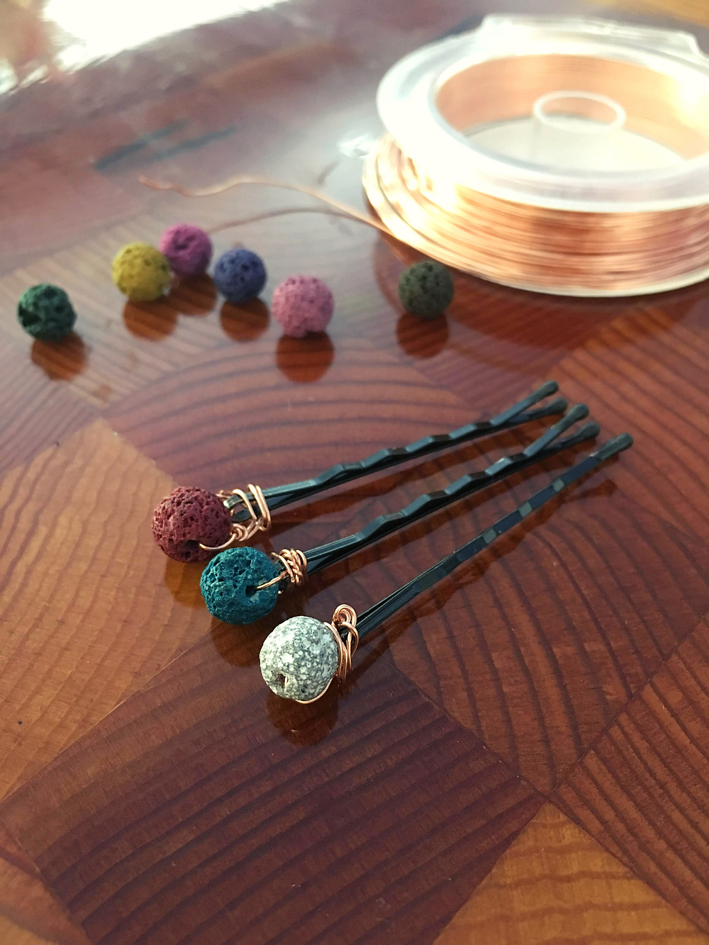 essential oil lava bead bobby pins for aromatherapy handmade by kid entrepreneurs as they learn to spend save and share. percentage donated to charity.