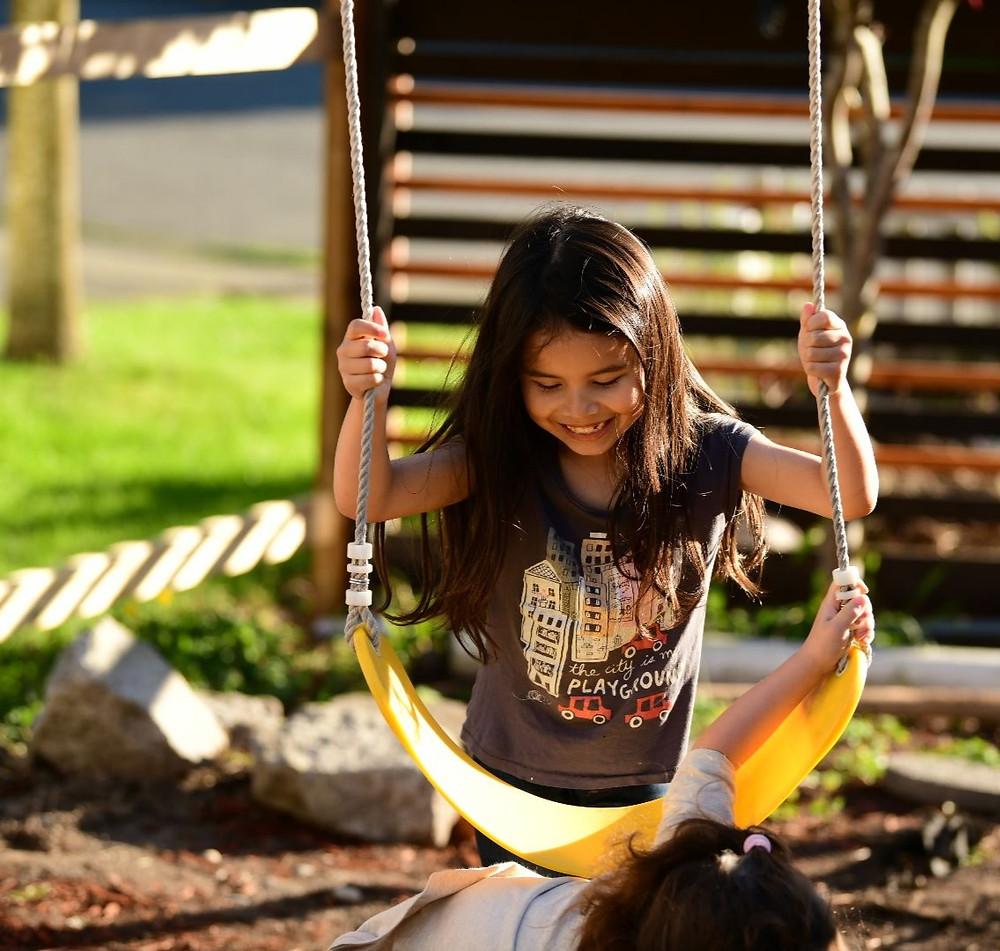 "<img src=""swing.png"" alt=""child entrepreneur plays on swing set with kid entrepreneur little sister"">"