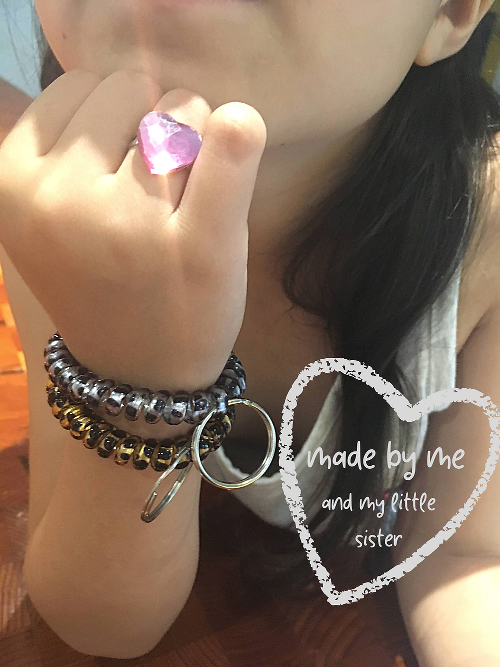 key ring wrist coils handmade by kid entrepreneurs as they learn to spend save and share. percentage donated to charity.