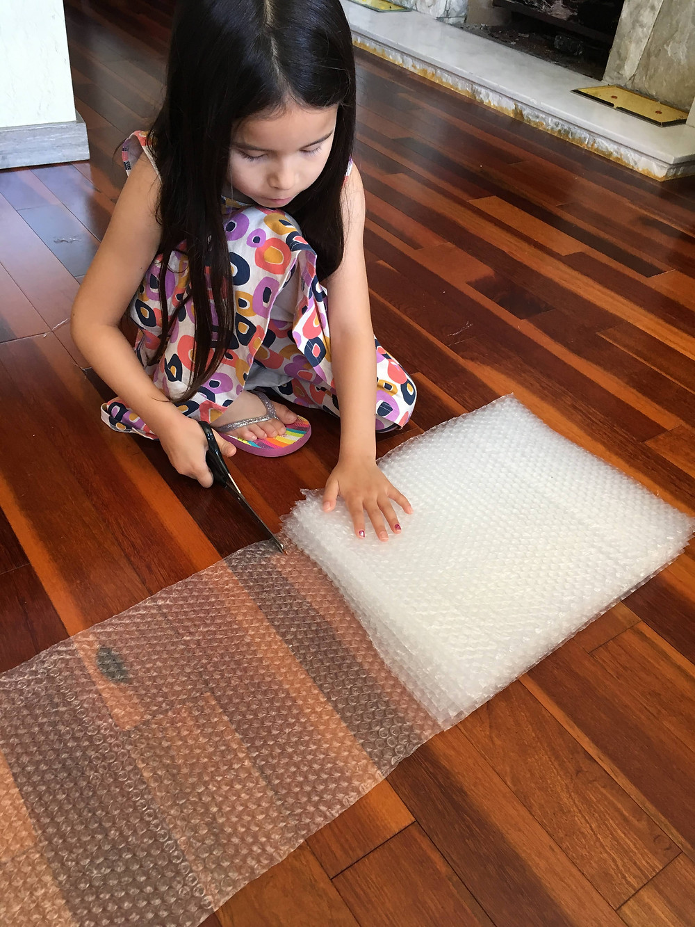 "<img src=""bubble-wrap.png"" alt=""girl cuts bubble wrap packaging to help family business>"