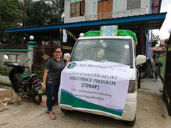 Ms. Kath with the vehicle used to trasport relief goods.