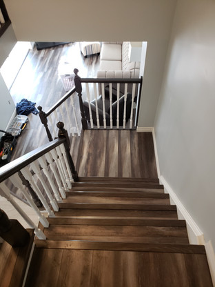 Laminate stairs and painted railing