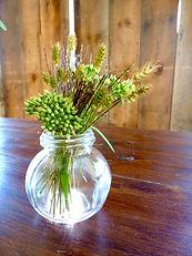 Grasses seedheads, gloing in a simpl glass jar.