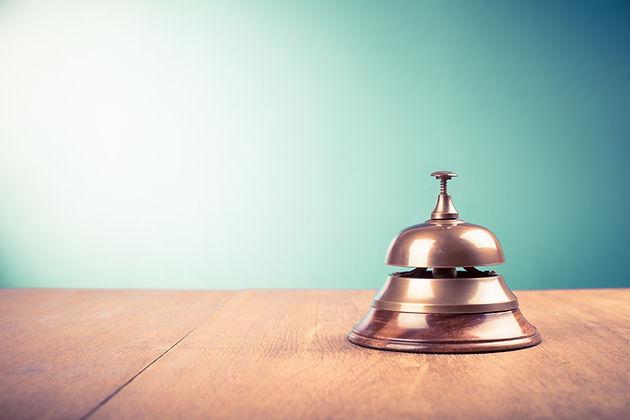 Vintage hotel reception service desk bell. Old retro style filtered photo.jpg