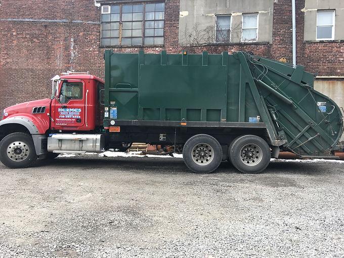 Red Garbage truck.jpg