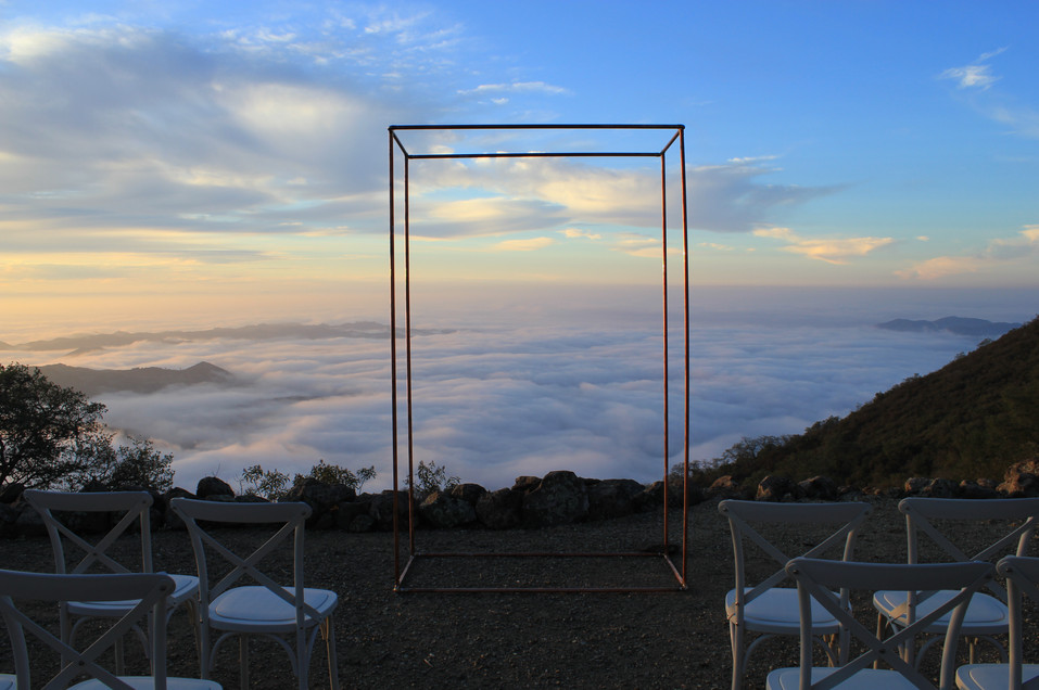 Copper wedding arbor with clouds