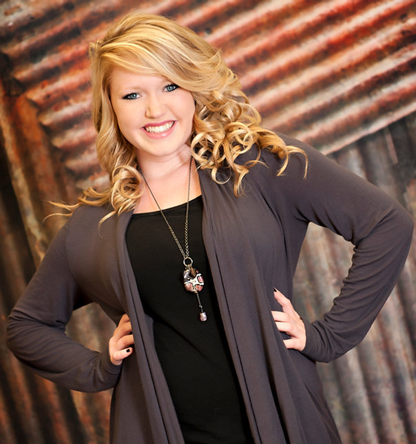Megan Christine, owner of this website, licensed cosmetologist, hairstylist