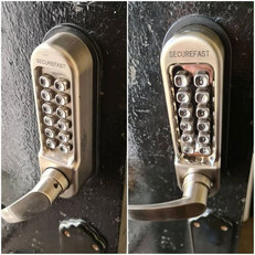 Old faulty code lock on communal door replaced with a nice shiny working one
