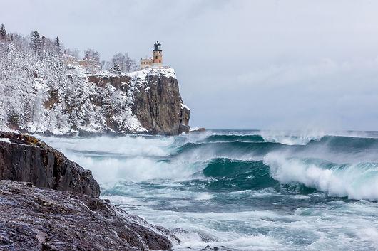 Lake Superior waves roll onto the shorel