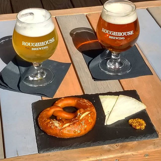 Roughhouse beer with a German pretzel and River Whey cheese.