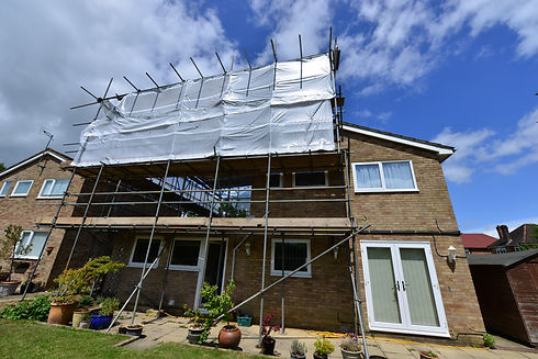 Scaffolding on the back of a house in th