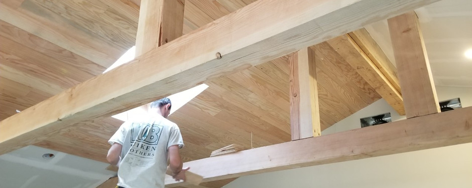 Men working on rooftop by home builders in Upper Saddle River, NJ