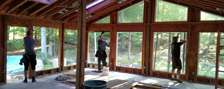 Men working on house by home builders in North Caldwell, NJ