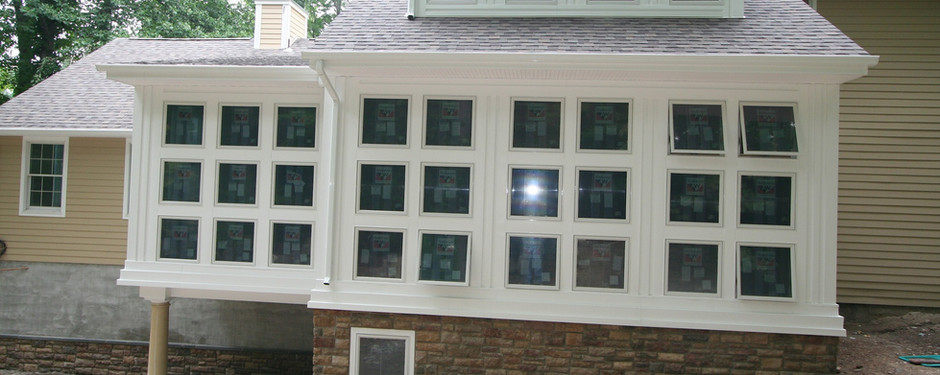 Another back door image of house by custom home builders in Upper Saddle River, NJ