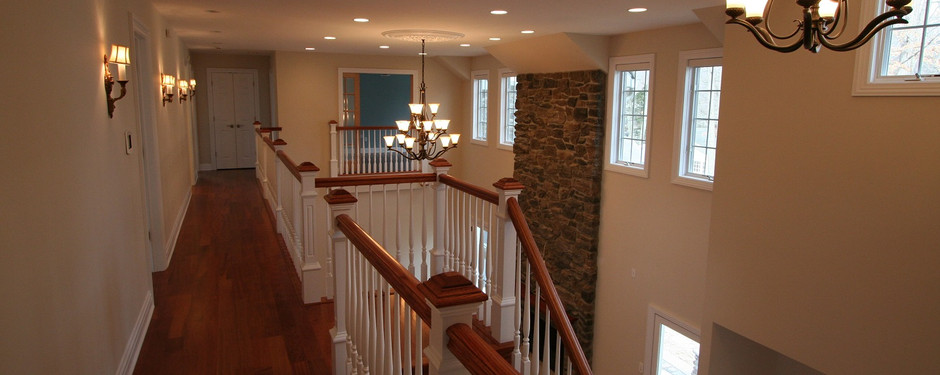 Stunning hallway with staircase by home remodelers in Upper Saddle River, New Jersey
