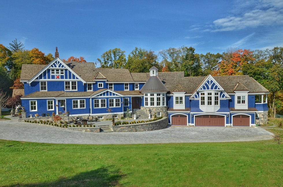 Blue home by custom home builders in Mountain Lakes, NJ