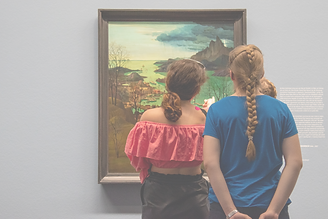 Girls looking at a painting inside Albertina Museum of Vienna