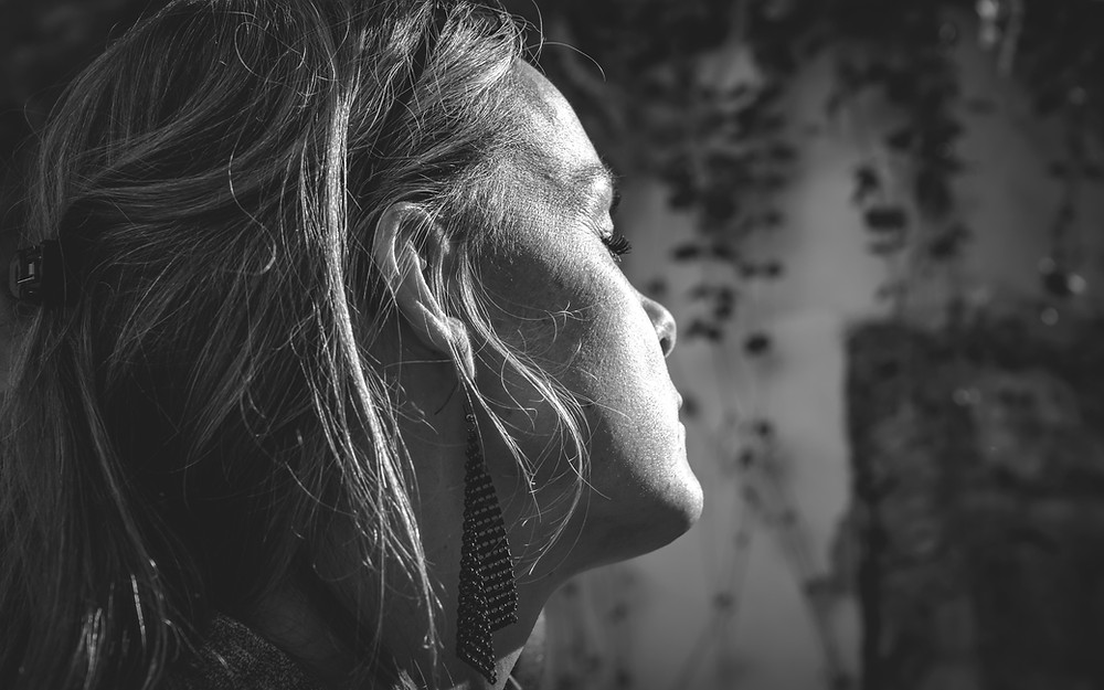 dramatic black and white photo of woman