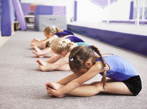 young-gymnasts-performing-warming-up-rou