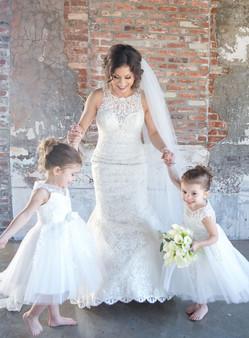 tara-marie-bride-and-two-kids-holding-hands.jpg
