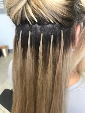 Highlighted keratin tip hair extensions applied on hair.