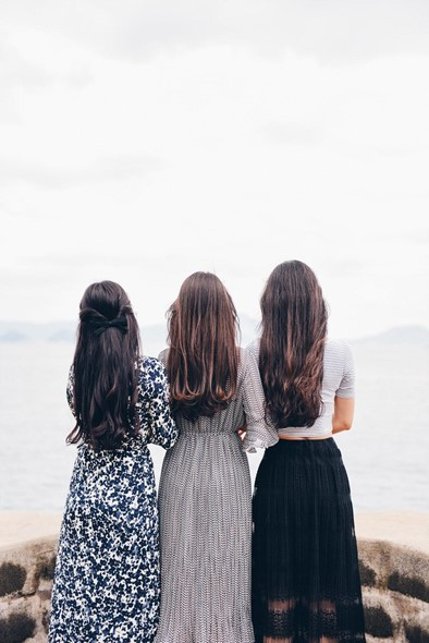 3 ladies with long hair extensions installed.