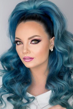 90s inspired hair with blue extensions.