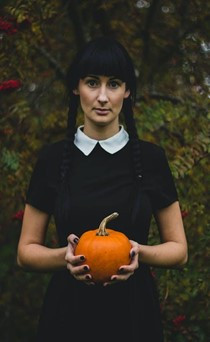 A model wearing the Wednesday Addams look.