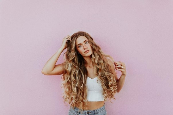 A girl with long hair extensions.