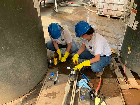 J&E Installing pumps.jpg