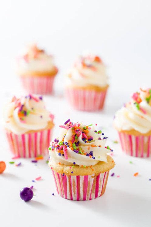 20 mini vanilla cupcakes with vanilla creme icing & sprinkles