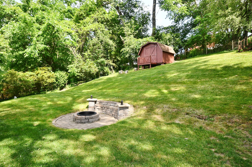 Storage shed and playhouse included