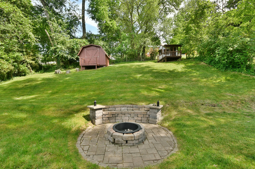 Stone firepit with built-in bench!