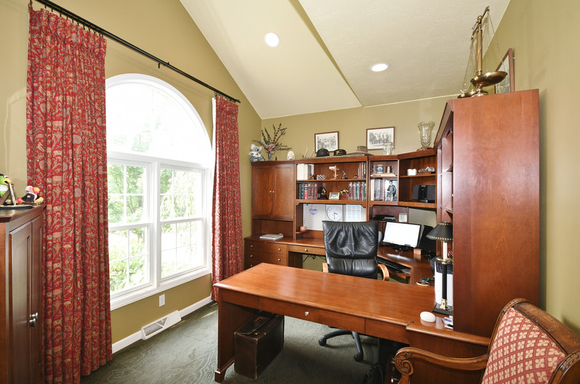 Home office on the main level comes with desk included!