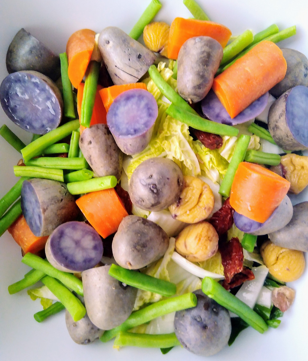 Raw and steamed vegetables with some beautiful Violetta potatoes and onion and miso sauce