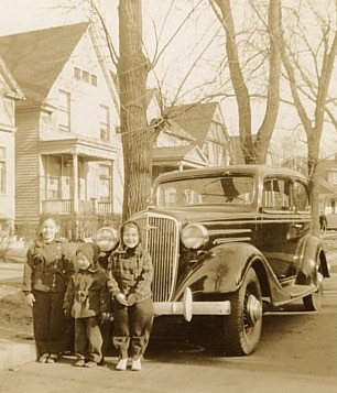 From left to right, Pauline age 6, Hubert age 3, Lucy, age 5 in front of the family's 1934 Chevrolet, 1940