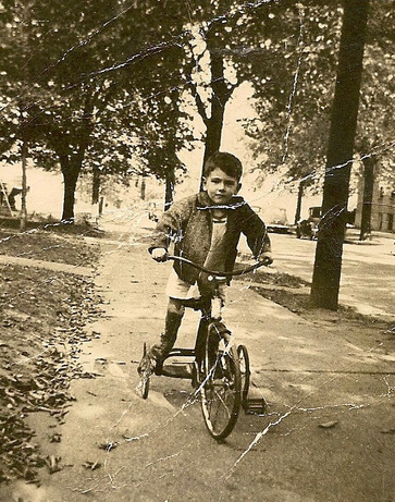 Pauline's brother Joe, age about 5, riding his tricycle on Pasadena Avenue in Detroit